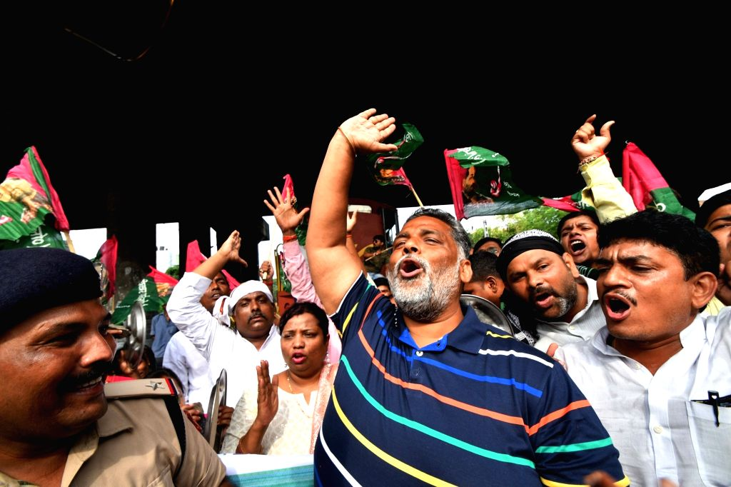 Jan Adhikar Party (JAP) workers led by its chief Pappu Yadav stage a demonstration as they block railway tracks and disrupt railway services during a nationwide shutdown protest - 'Bharat ... - Pappu Yadav
