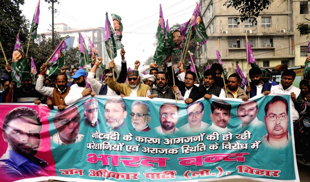 Jan Adhikar Party (JAP) workers participate in a march against demonetisation in Patna on Nov 28, 2016.