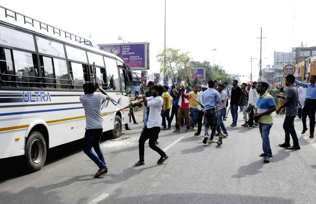 Jan Adhikar Party (JAP) workers stage a demonstration as they go on rampage and damage public vehicles during a nationwide shutdown protest - 'Bharat Bandh' against rising fuel prices called ...