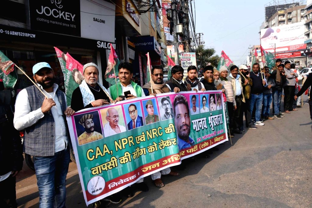 Jan Adhikar Party (JAP) workers stage a demonstration against the Citizenship Amendment Act (CAA) 2019, National Register of Citizens (NRC) and National Population Register (NPR), in Patna on ...