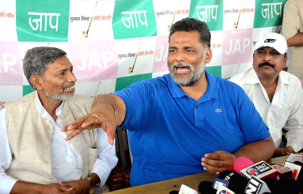 Jan Adhikar Party leader Pappu Yadav addresses a press conference in Patna on June 14, 2017. - Pappu Yadav