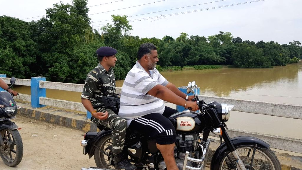 Jan Adhikar Party leader Pappu Yadav along with a soldier monitors the flood situation in Darbhanga, Bihar on Aug 20, 2017. - Pappu Yadav