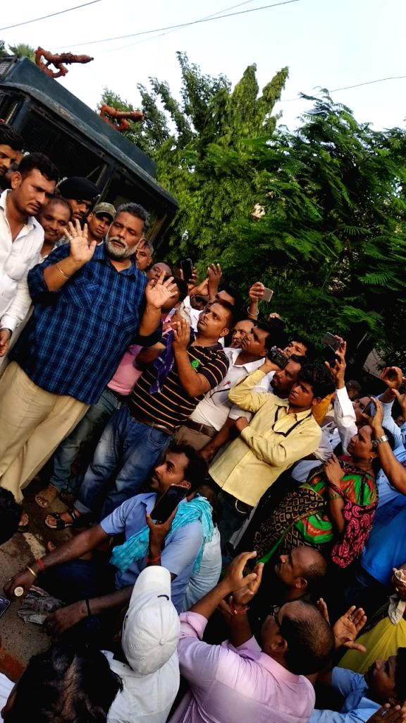 Jan Adhikar Party leader Pappu Yadav meets teachers after police charged batons on them during a protest in Patna on July 18, 2019. - Pappu Yadav