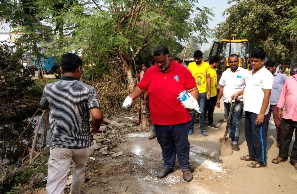 Jan Adhikar party leader Pappu Yadav participates in a cleanliness drive in Patna, on Oct 17, 2019. - Pappu Yadav
