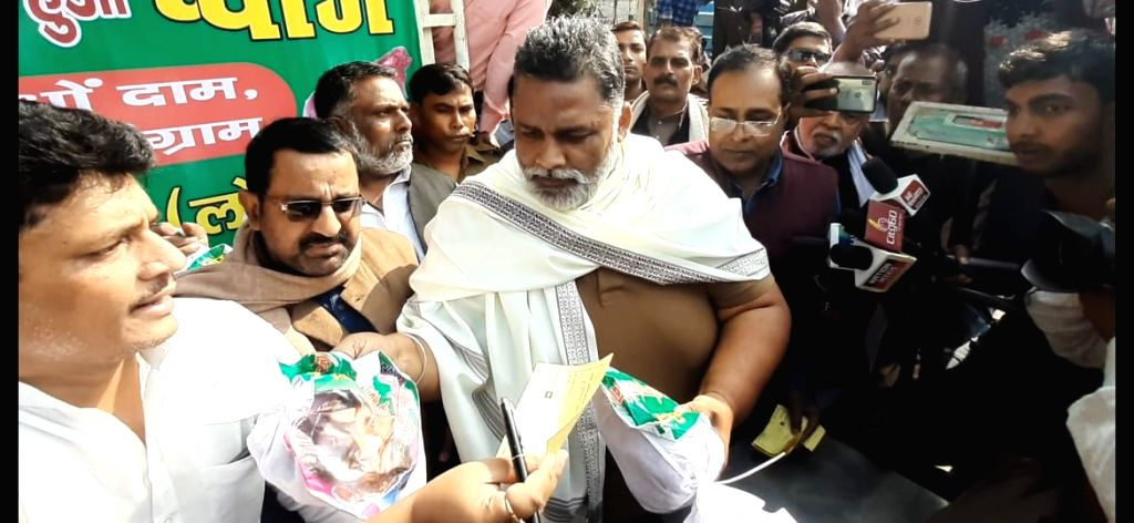 Jan Adhikar Party leader Pappu Yadav sells onions. - Pappu Yadav