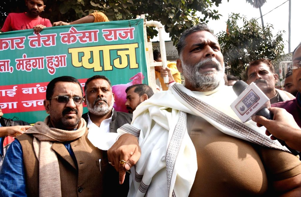 Jan Adhikar Party leader Pappu Yadav talks to the media while selling onions at cheaper prices outside a BJP office, during a protest against rise in prices of the vegetable across the ... - Pappu Yadav