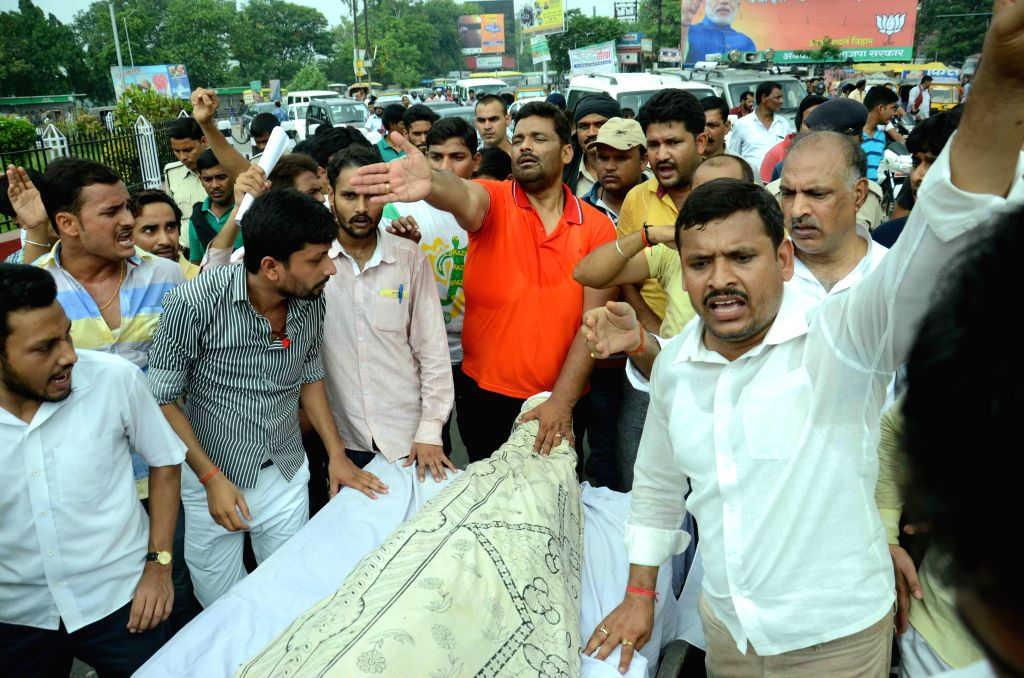 Jan Adhikar Party leader Rajesh Ranjan alias Pappu Yadav joins a protest by the family members of a person who died of injuries sustained during a lathi-charge by police on July 8, 2015.