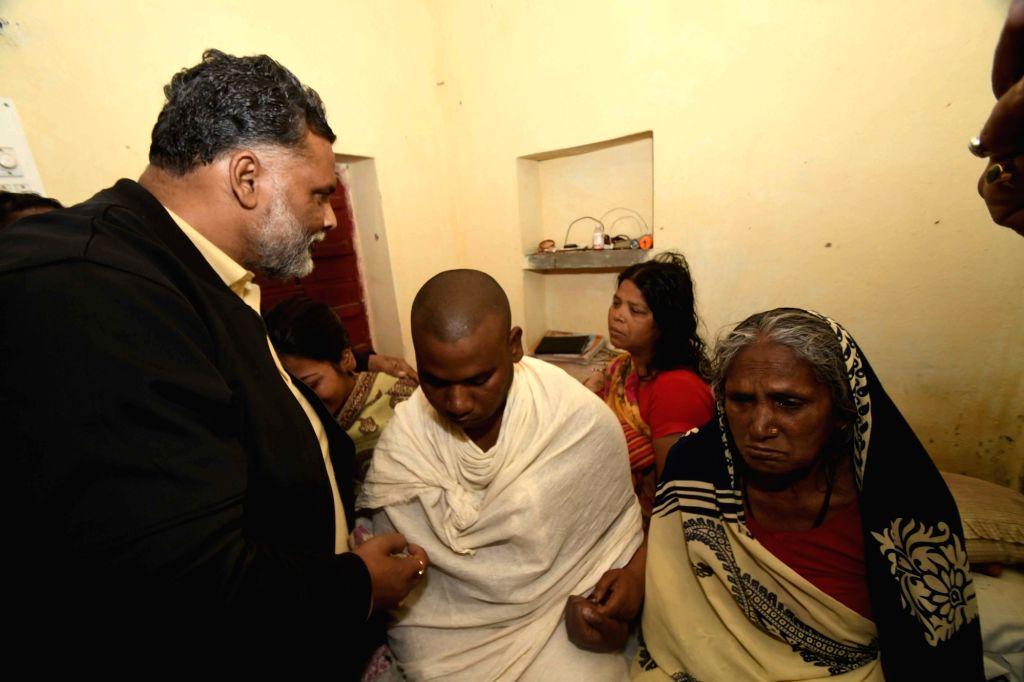 Jan Adhikar Party (Loktantrik) leader Rajesh Ranjan alias Pappu Yadav visits the grief struck family members of martyr Sanjay Kumar Sinha, one of the 49 CRPF personnel killed 14 Feb Pulwama ... - Pappu Yadav and Sanjay Kumar Sinha