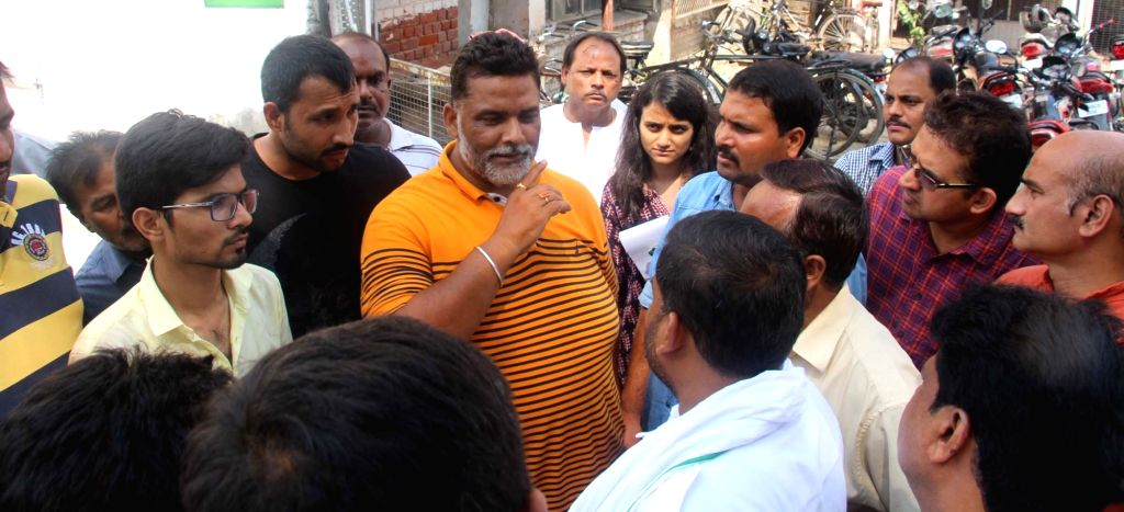 Jan Adhikar Party president Pappu Yadav meets the agitating parents protesting outside Ryan International School over death of 7-year-old Pradyuman in Gurugram on Sept 10, 2017. - Pappu Yadav