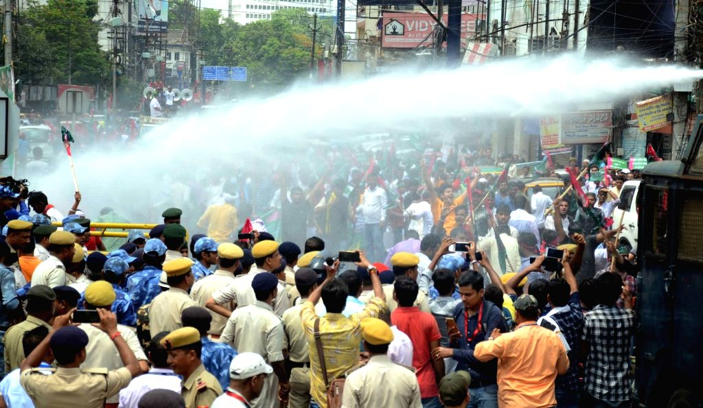 Jan Adhikar Party workers charged with water canons as they 'gherao' Bihar Assembly during a demonstration over the death of children due to AES deaths and flood situation in Bihar; in Patna ...