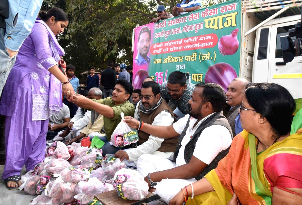Jan Adhikar Party workers sell onions at Rs 35 a Kg outside the office of Lok Janshakti Party in Patna on Dec 6, 2019. Onion prices in the country are on a surge with the highest recorded at ...