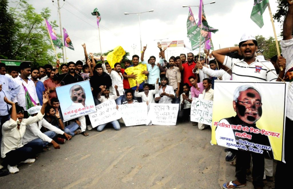 Jan Adhikar Party workers stage a demonstration against the police lathicharge on dalit students in Patna on Aug. 6, 2016.