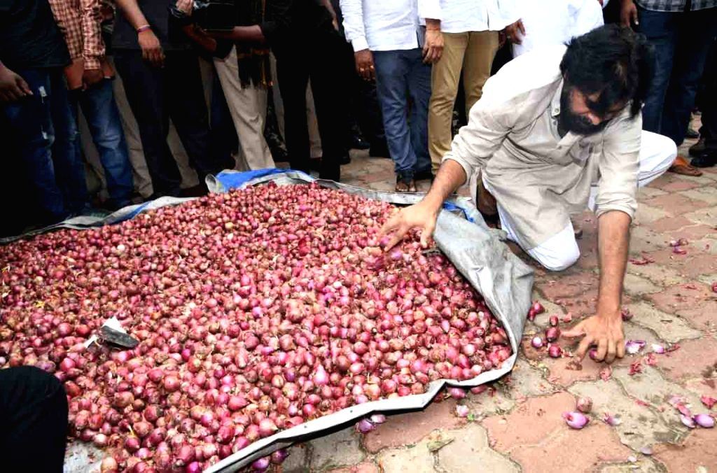 Jana Sena chief Pawan Kalyan sorts onions during his visit to farmers' market in Tirupati, Andhra Pradesh on Dec 3, 2019. This comes in the backdrop of soaring Onion prices in the country.