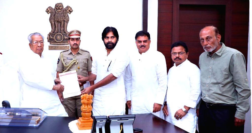 Jana Sena Party chief Pawan Kalyan accompanied by party leaders Nadendla Manohar, Arham Khan and Shiva Sankar, calls on Andhra Pradesh Governor Biswabhusan Harichandan and submits a ... - Arham Khan