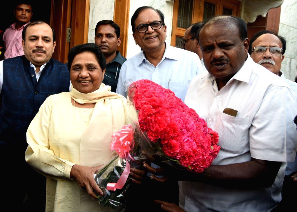 Janata Dal-Secular (JD-S) leader and Karnataka Chief Minister-designate H.D. Kumaraswamy meets BSP chief Mayawati, in New Delhi on May 21, 2018.