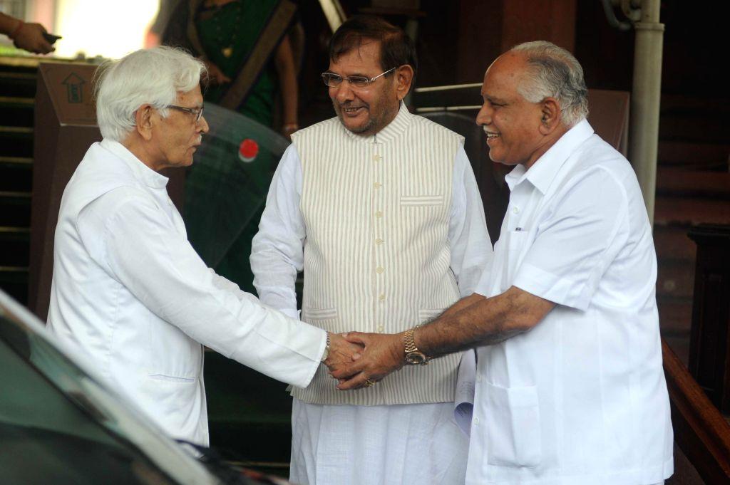 Janata Dal-United (JD-U) president Sharad Yadav, BJP leader and Shimoga MP BS Yeddyurappa and Congress leader Natwar Singh at the Parliament in New Delhi on Aug 6, 2014. - Sharad Yadav and Natwar Singh