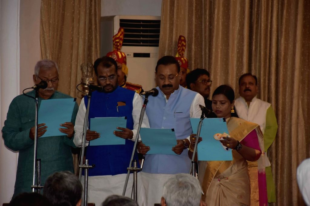Janata Dal (United) leaders take oath as Ministers in State government during Bihar cabinet expansion, in Patna, on June 2, 2019.