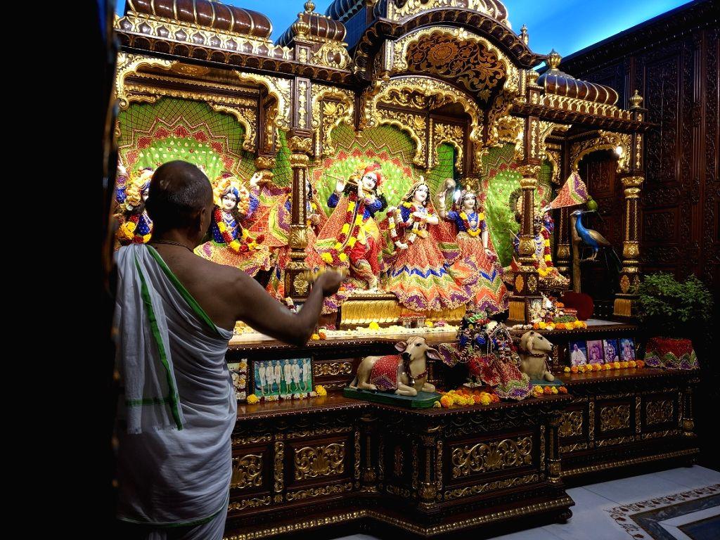 Janmashtami celebrations underway at the Radha Gopinath Temple, ISKCON Chowpatty in Mumbai on Aug 12, 2020. This year, Janmashthami & Dahi-Handi celebrations were held only inside temples ...