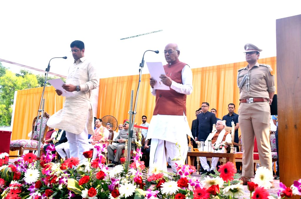 Jannayak Janta Party (JJP) chief Dushyant Chautala take oath as Harayana Deputy Chief Minister in the presence of State Governor Satyadeo Narain Arya during the swearing-in ceremony at ...