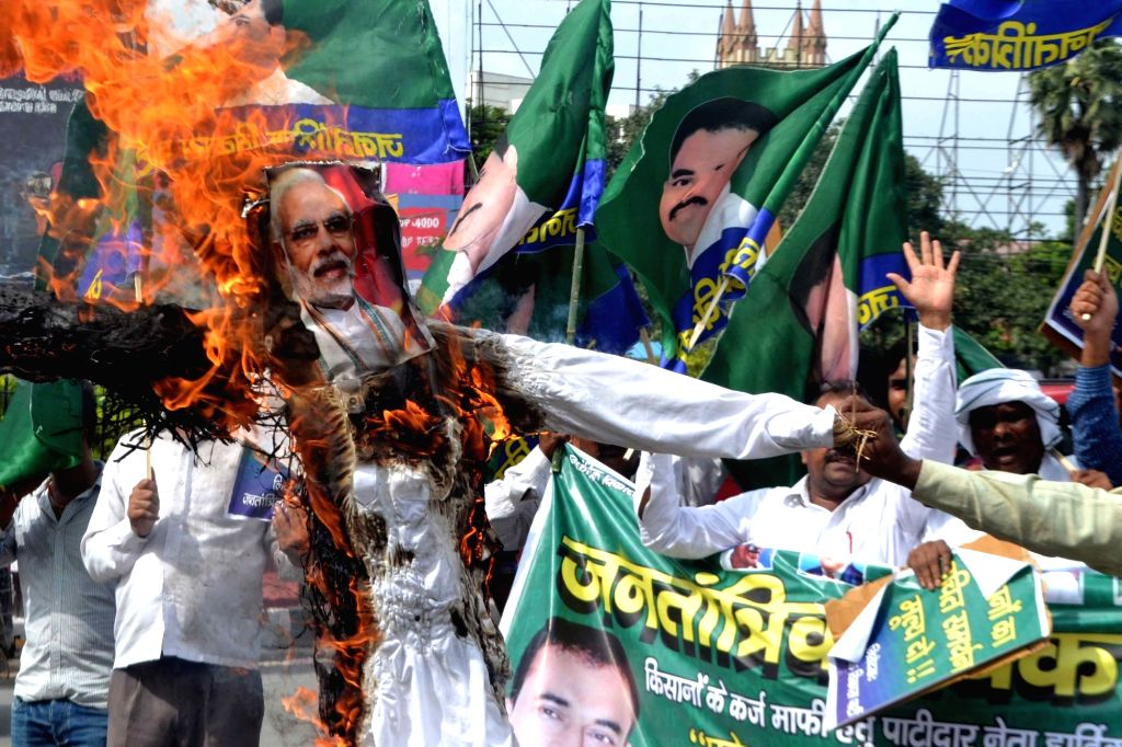 Jantantrik Vikas Party (JVP) workers burn the effigy of Prime Minister Narendra Modi as they stage a demonstration to press for their demands, in Patna on Sept 3, 3018. - Narendra Modi
