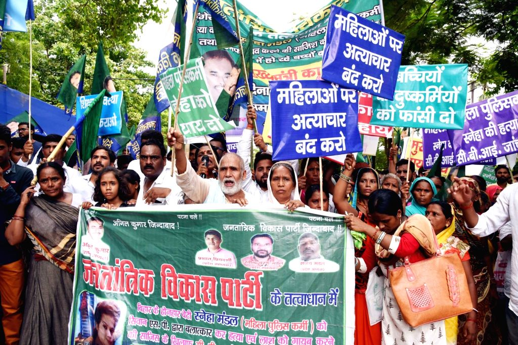 Jantantrik Vikas Party workers stage a demonstration against the death of constable Sneha Kumari, in Patna on July 16, 2019.