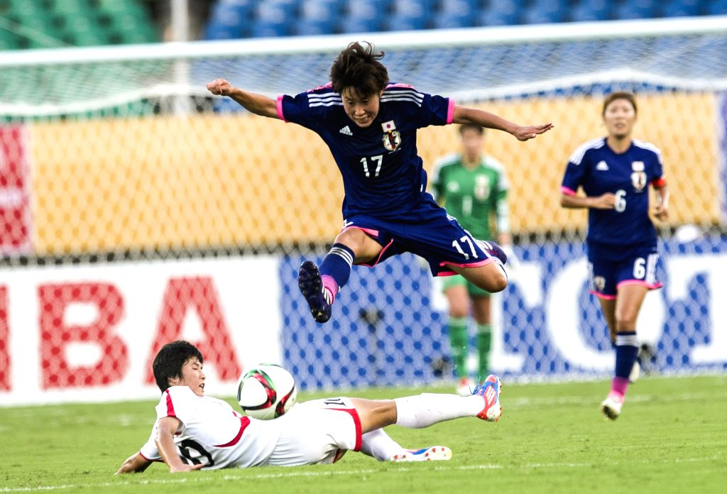 Japan's Arimachi Saori (Top) vies with Ra Un Kim of the Democratic People' s Republic of Korea (DPRK) during their match at the 2015 EAFF(East Asian Football ...