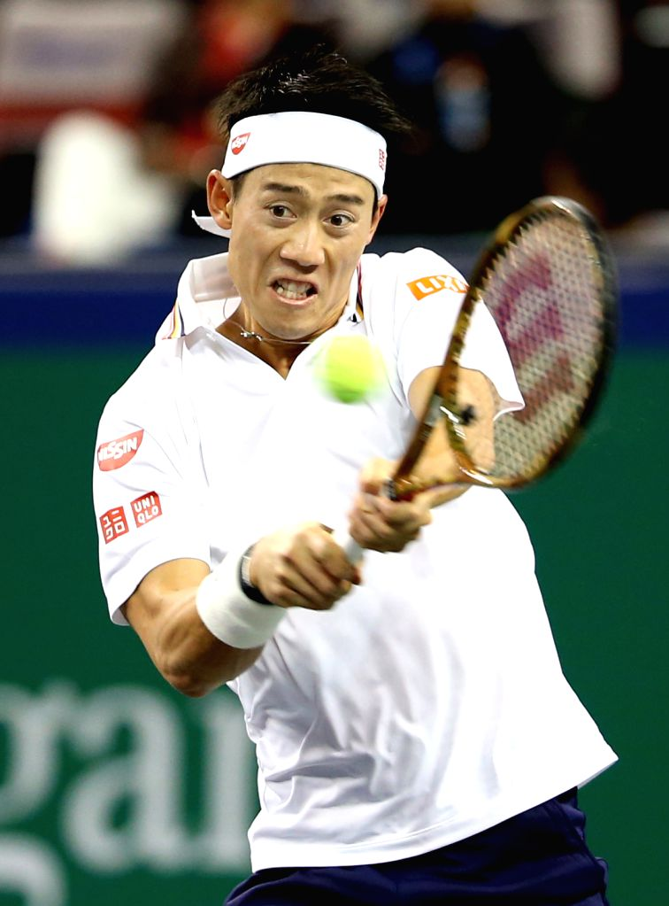 : Japan's Kei Nishikori hits a return during the men's singles second round match against China's Wu Yibing at the Shanghai Masters tennis ...