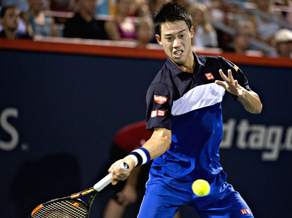 Japan's Kei Nishikori returns the ball against Britain's Andy Murray during their semifinal match of men's singles at the 2015 Rogers Cup in Toronto, Canada, August ...