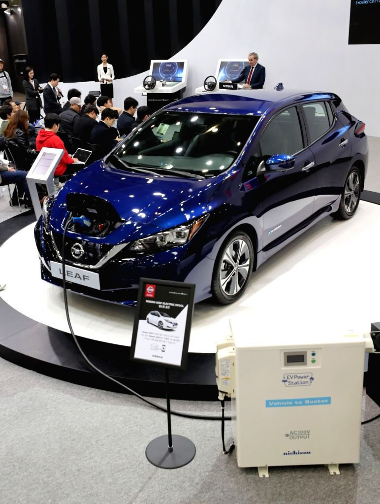 Japan's Nissan Motor Co. unveils the new model of its electric vehicle, Leaf, during the International Future Auto Expo at the exhibition and convention center in the southeastern city of ...