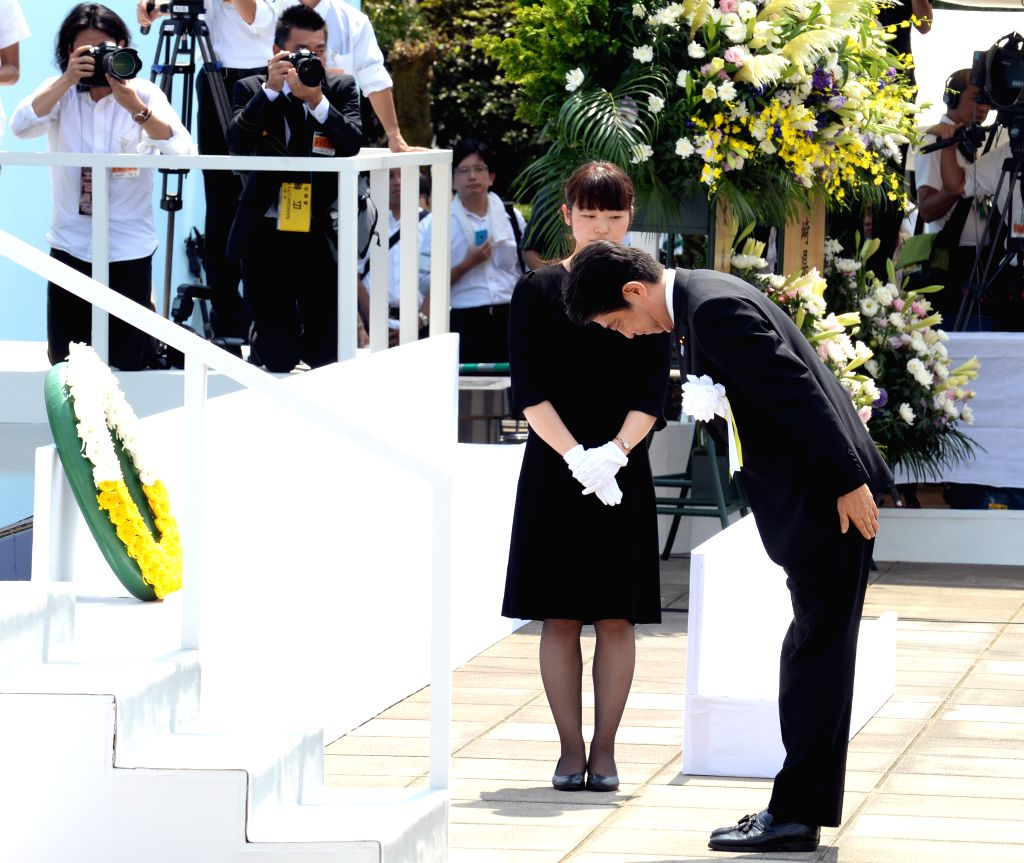 Japanese Prime Minister Shinzo Abe bows as he participates in a ceremony commemorating the 70th anniversary of the bombing of Nagasaki, at the Peace Park in ... - Shinzo Abe