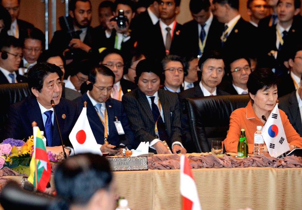Japanese Prime Minister Shinzo Abe (front L) and South Korean President Park Geun-Hye (front R) attend the 18th Association of Southeast Asian Nations ... - Shinzo Abe