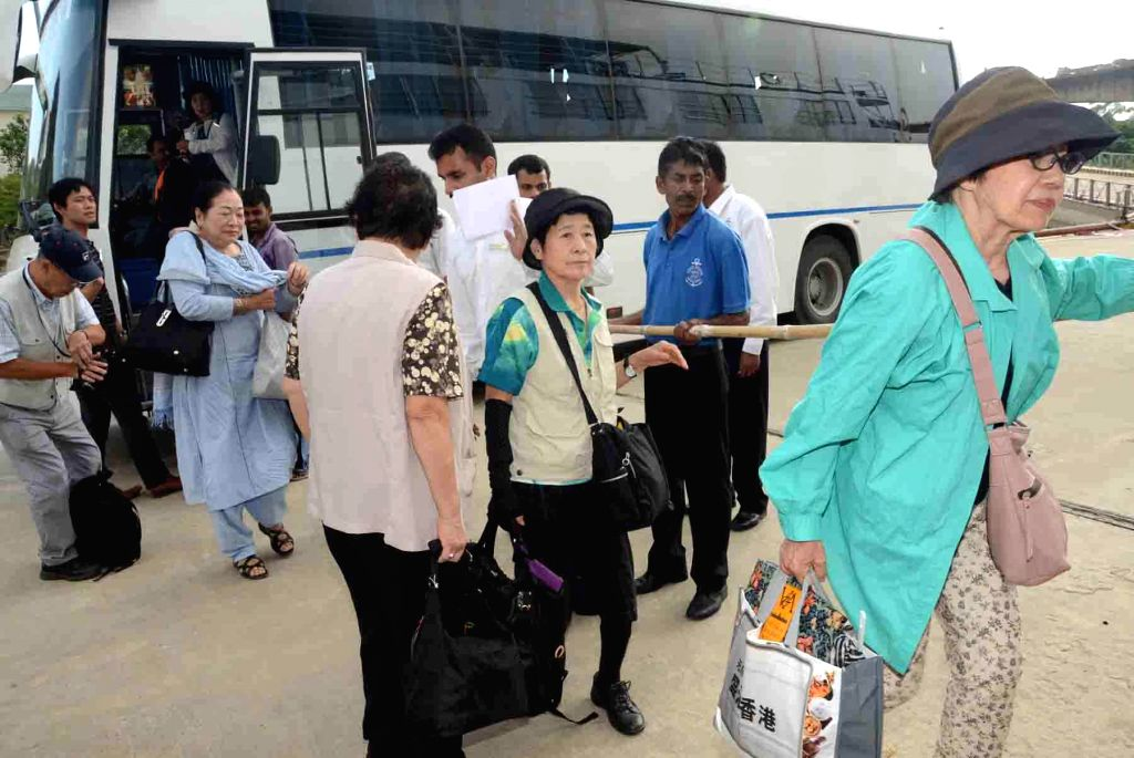 Japanese tourists board a cruise ship for Varanasi at Gay Ghat Jetty of Patna on Sept 6, 2014.