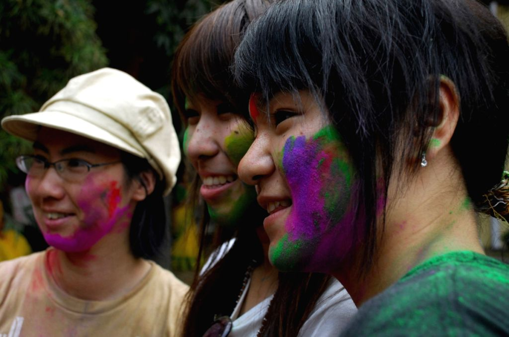 Japanies Student of Rabindra bharati University observe Vasanta Utsav at Rabindranath Tagore House in Kolkata on Monday 9th Mar 09, The Noble laureate had been so inspired by the spirit of Holi, that