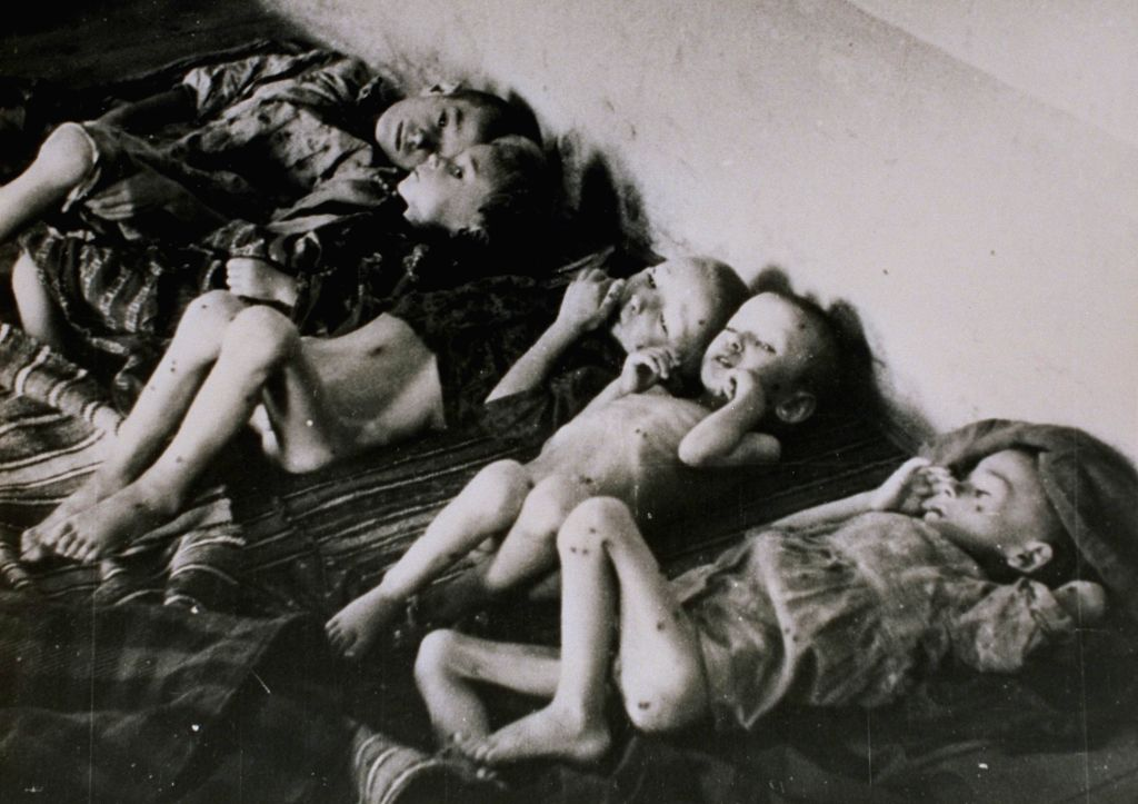 A handout photo from Jasenovac Memorial Museum taken in Stara Gradiska Concentration camp in 1942 shows ill children in an attic room. Children were from the ...