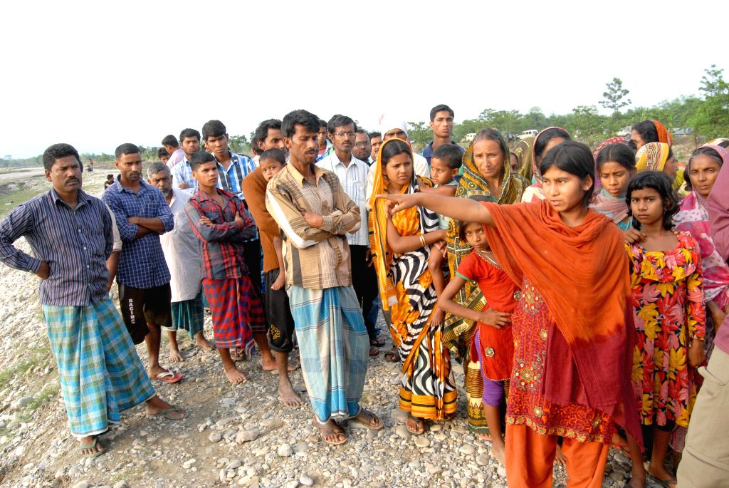 Jasmina Khatun (15) shows the spot where her two brothers Md Ariful Ali (5) and Md Lachan Ali (8) were killed by suspected NDFB (Songbijit) militants; at Narayanguri relief camp where she is ...