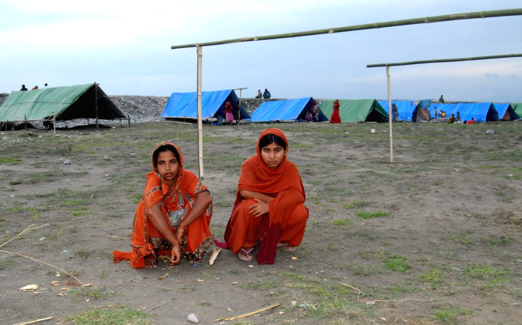 Jasmina Khatun (15) with her mother at Narayanguri relief camp in Raghav Beel under Goverdhana police station of Baksa district of BTAD in Assam on May 5, 2014.