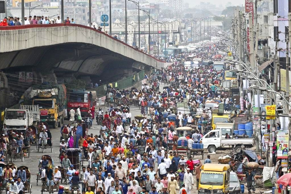 """:Jatrabari: People walk on foot during a 48-hour nationwide strike called by transport workers demanding amendments to the """"Road Transport Act 2018"""" threw normal life out of gear across the ..."""