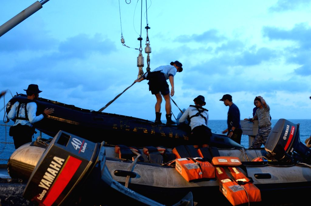 Indonesian Navy divers prepare to lift the tail of AirAsia Flight 8501 in Java sea, Indonesia Friday, Jan. 9, 2015. Indonesia said on Jan. 7, 2015 it had found the .