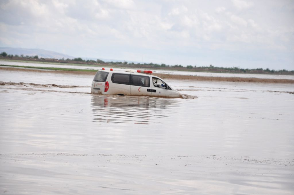 A car drives through a flooded area in Northern Province Jawzjan, Afghansitan, April 25, 2014. Heavy rains and flooding have claimed the lives of nearly 40 people .