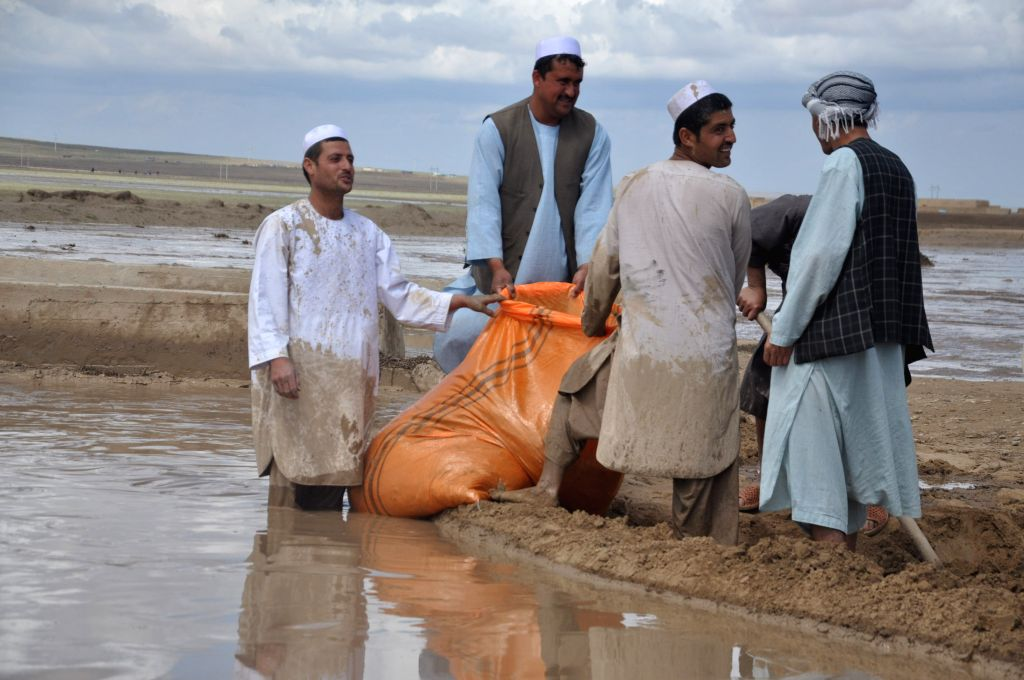 Local people try to reconstruct the road and dam in Northern Province Jawzjan, Afghansitan, April 25, 2014. Heavy rains and flooding have claimed the lives of ...