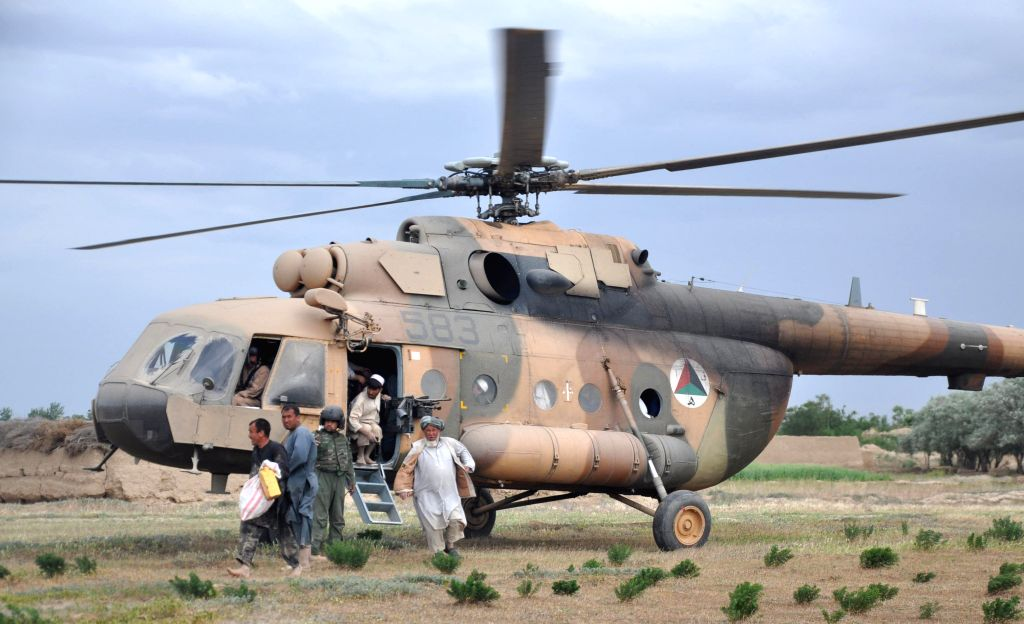 Members of the Afghan National Army Air Forces transfer people to a safe place after flooding in Northern Province Jawzjan, Afghanistan, April 25, 2014. Heavy ...