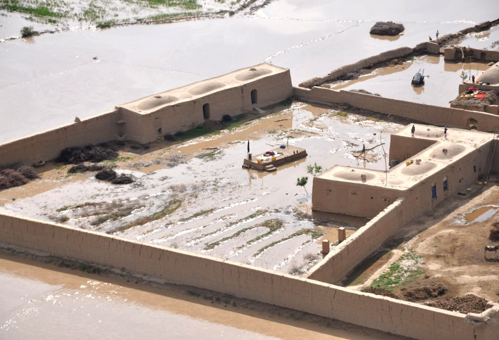 Photo taken on April 25, 2014 shows a view of a disaster area after flooding in Northern Province Jawzjan, Afghanistan. Heavy rains and flooding have claimed the ..