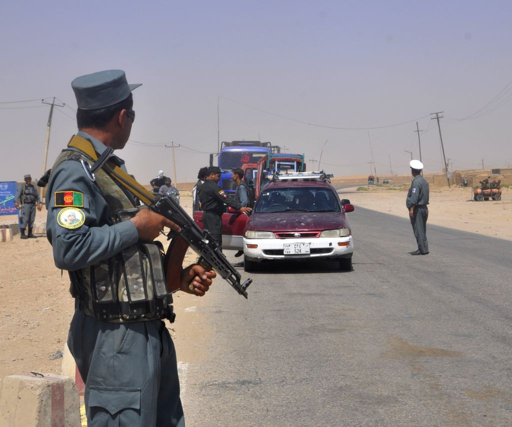 JAWZJAN, July 24, 2018 - A policeman stands guard at a security checkpoint in Jawzjan province, Afghanistan, July 24, 2018. Up to 17 militants loyal to the Taliban outfit and Islamic State (IS) group ...