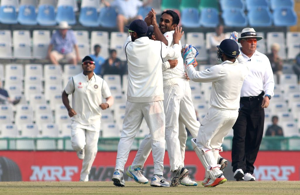 Jayant Yadav of India celebrates fall of a wicket on Day 4 of the third test match between India and England at Punjab Cricket Association IS Bindra Stadium, Mohali on Nov 29, 2016. - Jayant Yadav