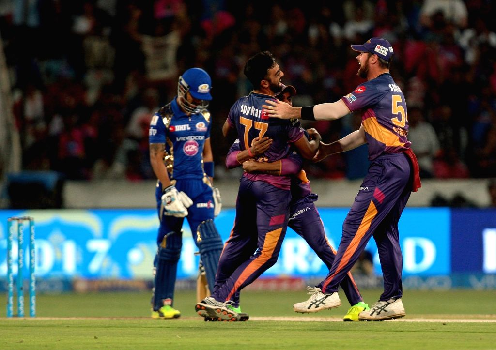 Jaydev Unadkat and Manoj Tiwary of Rising Pune Supergiant celebrate fall of Lendl Simmons' wicket during the final match of IPL 2017 between Mumbai Indians and Rising Pune Supergiant at ...
