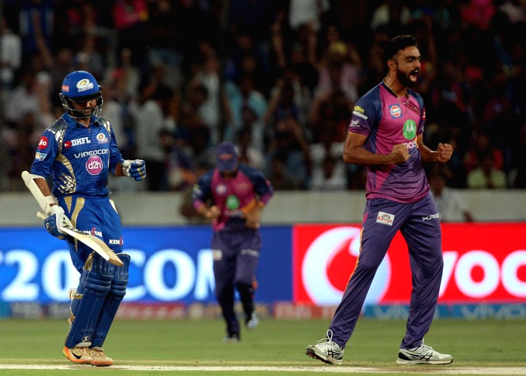 Jaydev Unadkat of Rising Pune Supergiant celebrates fall of Lendl Simmons' wicket during the final match of IPL 2017 between Mumbai Indians and Rising Pune Supergiant at Rajiv Gandhi ...