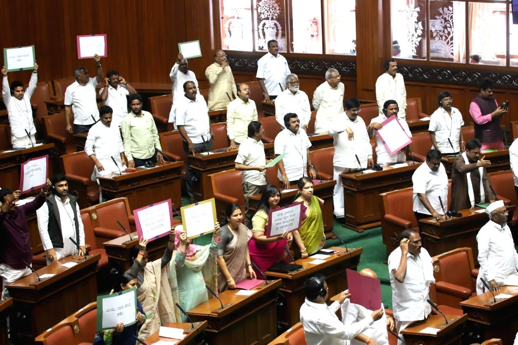 JD-S and Congress legislators protest against the disruption caused by BJP MLAs during the Budget Session of Karnataka Assembly, in Bengaluru on Feb 9, 2019.