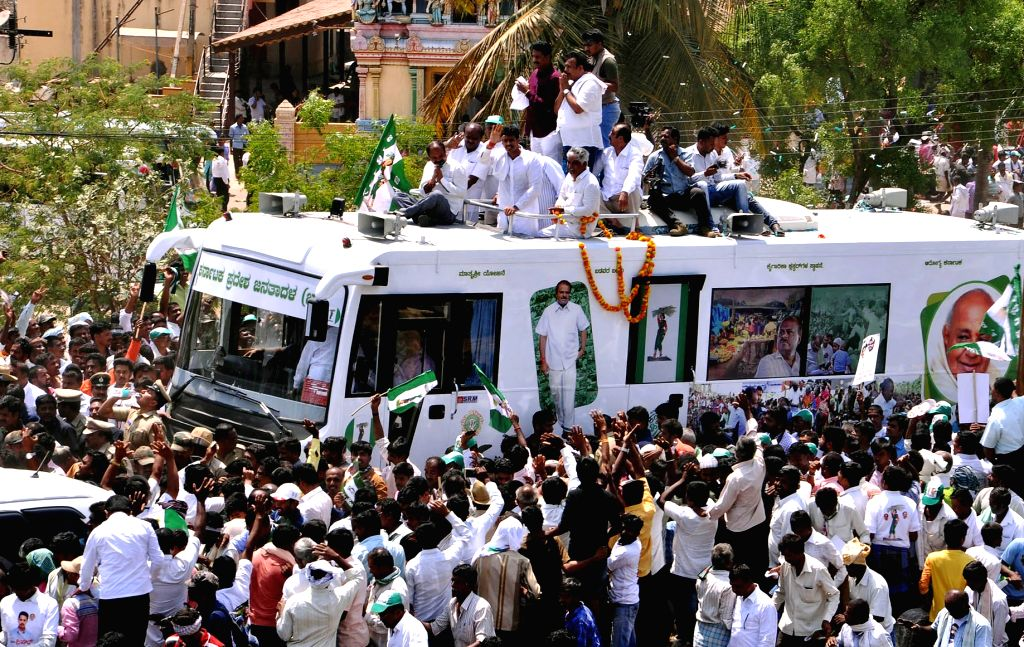 JD-S-Congress' Lok Sabha candidate from Mandya, Nikhil Kumaraswamy along with his father and Karnataka Chief Minister H.D. Kumaraswamy and Congress leader D. K. Shivakumar on his way to file ... - H.