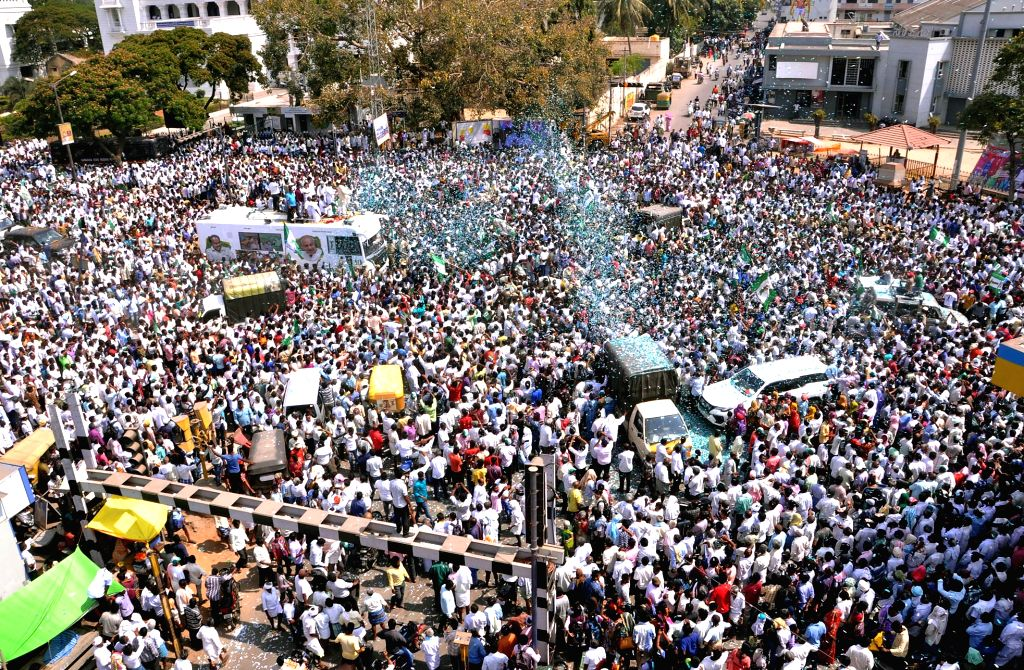 JD-S-Congress supporters participate in a procession to accompany Karnataka Chief Minister H.D. Kumaraswamy's son and JD-S-Congress' Lok Sabha candidate from Mandya Nikhil Kumaraswamy as he ... - H.
