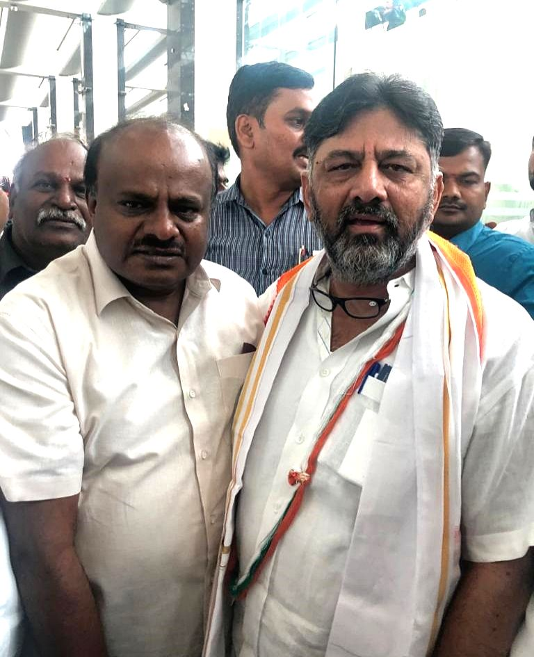 JD-S leader H. D. Kumaraswamy welcomes Congress leader and former Karnataka minister D.K. Shivakumar on his arrival at the Kempegowda International Airport after the latter was granted ... - D.